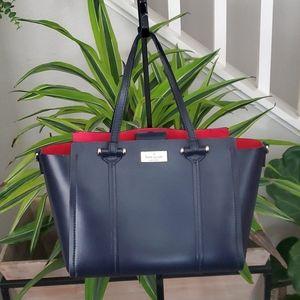 Kate Spade Navy with Red interior Handbag